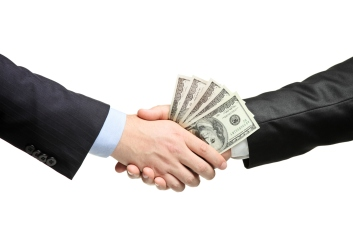 Handshake with money